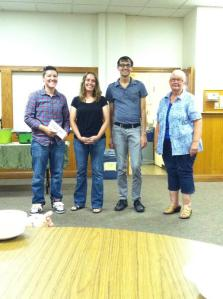 The SGL team (Heather, Joel, and Terry) with June winner, Terra